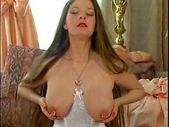 Bitch Puts Some Piercings In Her Nipples