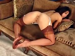 Teasing brunette wearing fully fashioned stockings and a garter