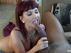 Redhead siren gets pleased by a black dude and loves his dick