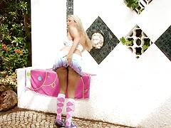 Playsome blonde in weird socks plays a kinky solo with a toy