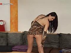 Freaky brunette with oiled body fucks herself with a dildo dong