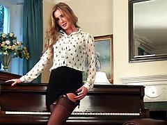 Elegant milf in black nylon stockings masturbates on her piano
