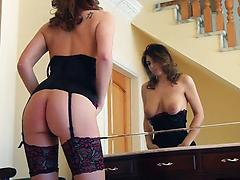 Busty vixen in chic lingerie and stockings rubs hairy twat